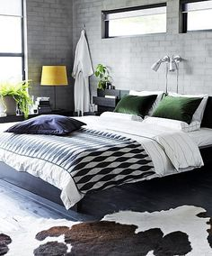 IKEA bed with black & white duvet cover #bedroom. love the brick wall and the green velvet pillows