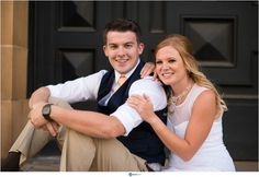 Hawaii Wedding Photographer Joseph Esser at Engagement Session Downtown Honolulu Couple sitting in front of door black orange white