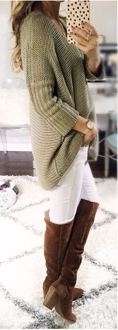 Oversized olive sweater with white jeans and brown OTK boots.