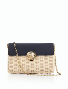 Gold details + seashell clad = a summer staple. Shop our Wicker Clutch.