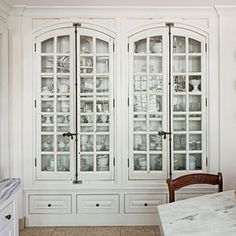 Built-ins make beautiful solutions for any space and ensure that there is a place for everything. This dreamy china cabinet features antique French windows as doors, plenty of space for china, and a base outfitted with Pacific Silvercloth for storing silver.  China Treasure Chest | SouthernLiving.com