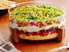 Get Food Network Kitchen's Eight-Layer Chicken Chili Dip Recipe from Food Network