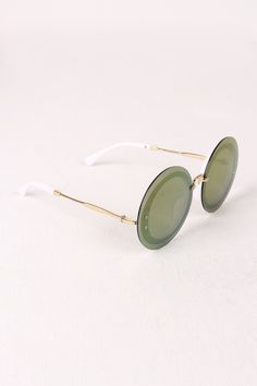 """Rimless Round Mirrored Sunglasses by Conceited Doll These sunglasses feature a rimless design with screw detail, round mirrored lenses, metallic wire arms, and nose bridge cushions.Measurement Measures approx. 2.6"""" L x 5.6"""" W."""