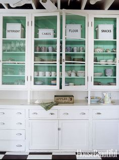 A surprise turquoise hue elevates boring old white when peeking out from behind a cottage kitchen's glass-front cabinets.Click through for more kitchen cabinet ideas.