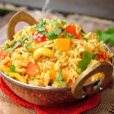 An easy breezy rice pulao cooked with a lot of bell peppers and flavored with a special  Indian spice mix.