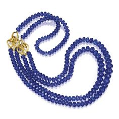 18 Karat Gold and Tanzanite Bead Necklace, Henry Dunay Composed of numerous tanzanite beads measuring approximately 13.5 to 7.4 mm, gathered at the sides by two scrollwork links, length 36 inches, signed Dunay.