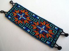 Mexican Huichol Loom Beaded bracelet by Aramara on Etsy Beaded Flowers Patterns, Bead Loom Patterns, Peyote Patterns, Bracelet Patterns, Beading Patterns, Bead Loom Bracelets, Woven Bracelets, Beaded Anklets, Beaded Jewelry