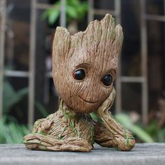 Baby Groot with a Flowerpot in his head! The cutest Flowerpot you will ever own. A bust of Baby Groot from Marvels Gaurdians of th Galaxy Vol. by Groot is high and can hold pens a plant or any other small treasures or trinket you may have. Figurines D'action, Groot Figurine, Baby Groot Action Figure, 2 Baby, I Am Groot, Christmas Gifts For Kids, Christmas Items, Guardians Of The Galaxy, Plant Holders