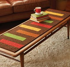 The clean lines and uncomplicated design of the Autumn Palette table runner, by Patrick Lose, give it a modern aesthetic. Make this table quilt pattern in fall colors to decorate your home throughout the autumn months or use the colors of your choosing to accommodate your favorite season.