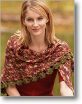 A simple triangular shawl with delicate flower edging is made interesting with kettle-dyed yarn.