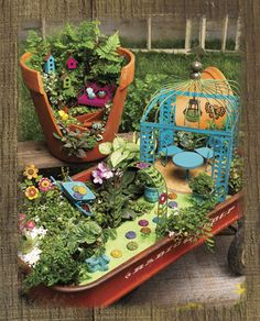 Fairy Garden in a wagon.  Wonder what I could DIY for the stepping stones...buttons, maybe?