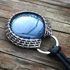 Halo Pendant Wire Wrapped Tutorial. This tutorial will teach you how to weave a cabochon frame, make and bind a heavy wire backing and secure a cabochon or flat bead and make a woven bail. You will also learn how to make a hook and eye clasp and how to bind them to a necklace #wirejewelry