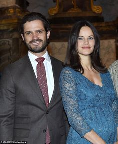 Princess Sofia, pictured with husband Prince Carl Philip, puts a protective hand over her bump. The Swedish royal, 31, is due to give birth in April 2016
