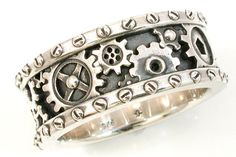 If you find golden bands boring and a tattoo ring too trendy, try hunting around for a ring that has personality. These steampunk bridal bands are the perfect blend of traditional and stylish.