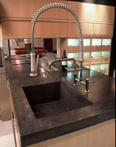 concrete kitchen counters with dark tint...my next project.
