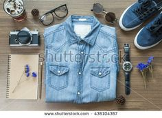 Top view Flat lay of men's jean shirt with eyeglasses,film camera,sunglasses and sneaker hipster background concept copy - stock photo