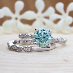 Items similar to Moissanite Wedding Ring Set, White Gold Blue Round Half Eternity Diamond Band, Bridal Ring Set on Etsy Best Diamond, Diamond Bands, Diamond Cuts, Blue Wedding Rings, Wedding Rings Simple, Wedding Bands, Moissanite Wedding Rings, Moissanite Diamonds, Bridal Ring Sets