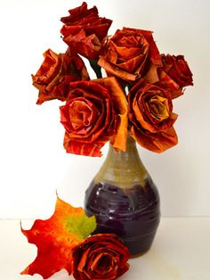 Paper artist Kate Hurst put an autumnal spin on romantic roses by crafting them out of colorful maple leaves from her backyard.  Get the tutorial at Design*Sponge. RELATED: 18 Quotes That Will Make You Fall in Love with Autumn