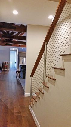 Cable Railing for Staircase | Stainless steel round posts, cedar handrail, and cable infill