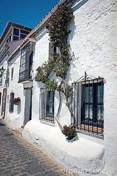 Mijas Pueblo architecture, white houses and flowers everywhere, province Andalusia in Spain