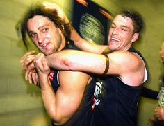 Brendon Fevola and Heath Scotland celebrate after winning the round 22 AFL match against Collingwood the MCG on August 27, 2004
