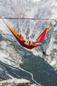 22 Daredevils Lounging in Hammocks Suspended Between Two Cliffs in the Italian Alps