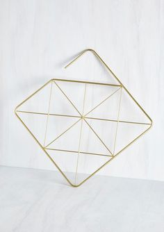 Organize your fabulous accessories with the enduring flair of this metal hanger! Captivating in its geometric simplicity, this matte gold piece brings endlessly contemporary allure to your collection of scarves or tights. Scarf Organization, Scarf Hanger, Indie Outfits, Indie Clothes, Small Space Interior Design, Metal Hangers, Home And Deco, Dorm Decorations, Modcloth