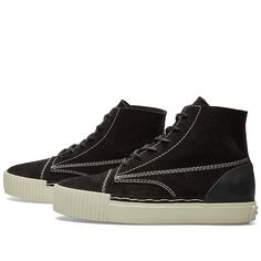 Contemporary New York designer Alexander Wang garnered a dedicated following based on his downtime sensibility and high-quality fabrics. Turning his attention to the realm of footwear, the eponymous designer delivers a highly-considered iteration of a high-top silhouette. Sculpted with premium suede leather uppers with tough rawhide laces, these contemporary Perry Suede Sneakers deliver an ergonomic fit, reinforced with vulcanised rubber to the sole unit, changing the perception of a…