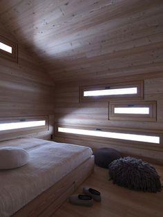Jagdhaus Tamers by EM2 ARCHITEKTEN  Platform bed with storage drawers