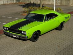 """One badd ass 68 Plymouth Roadrunner, AND it's a """"HEMI"""", says so on his """"vanity plate"""" if u seriously zoom in. I love the color """"Grabber Green"""""""