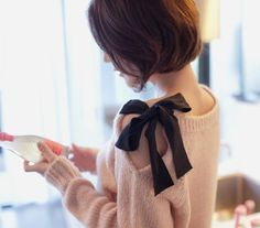 """Sweater Embellishments: Take an old sweater. Cut a slit in along the shoulder down about 7"""". Fold over raw edge and sew in place. Sew a piece of ribbon about 15"""" long to one side of neckline and another ribbon to the other side of the neckline. Tie together."""