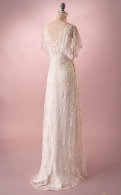 Vivian by Martin McCrea   Flowing silk chiffon, embroidered and beaded wedding dress with wrap style bodice and kimono style cap sleeves.