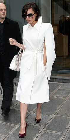 Who made Victoria Beckham's purse, white jacket, red pumps and sunglasses that she wore while shopping in Paris?
