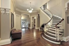 Foyer with curved staircase. Foyer in traditional suburban home with curved staircase. Foyer Design, Curved Staircase, Staircase Design, Staircase Ideas, Grand Staircase, Stair Railing, Interior Staircase, Stair Design, Spiral Staircases