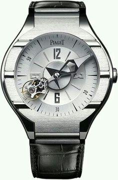 PIAGET polo tourbillon rotatif   l'aiguille des minutes, qui a son centre de rotation au centre de la montre, effectue une rotation par heure. La cage de tourbillon, suspendue sur l'aiguille des minutes, effectue une rotation sur elle-même par minute.