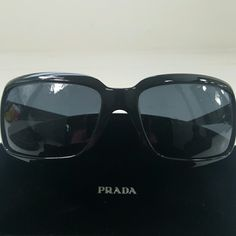 PRADA SUNGLASSES Made in Italy  Lens + frame 2 inches tall, 2.50 wide Entire front 7 inches lens to told on side Arm is 0.75 tall on side Film on lens has flakes  A few small minor scratches Prada Accessories Sunglasses