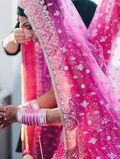 Traditional Indian bride wearing a pink bridal lehenga