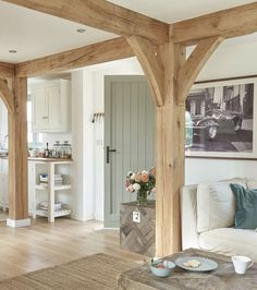 I like the beams because they add a country/outdoor feel, but they might get in the way. Definitely like the ceiling beams though