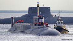 Past meets future: The soon to be decommissioned Akula-class (NATO: Typhoon) nuclear ballistic submarine Dmitriy Donskoy shadows the newest member of the Russian navy, the Borei-class nuclear. Borei Class Submarine, Soviet Navy, Russian Submarine, Nuclear Submarine, Tug Boats, Yellow Submarine, Navy Ships, Military Equipment, Submarines