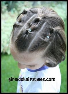 Cute pulled back look for short hair.  Definitely going to have to try this one on my lil' sweetie in the morning.