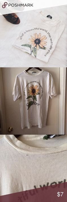 """Off-White """"What a Wonderful World"""" Sunflower Tee This shirt is perfect to sleep in, cut the top to make it off-the-shoulder, or tie at the bottom to wear with denim shorts! There are some flaws, as shown above. I am 5'4"""", a 34D, and this tee fits very loosely. The tag reads """"OSFA,"""" but I think it's more like a men's M or L. 100% Cotton. 0430170erg.  ✅Reasonable offers welcome! ✅BUNDLE DISCOUNTS! No trades/paypal/other apps. No lowball offers. Grass Raggs Tops Tees - Short Sleeve"""