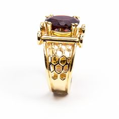 Oval Garnet Lattice Beehive Gold Ring | From a unique collection of vintage more rings at https://www.1stdibs.com/jewelry/rings/more-rings/