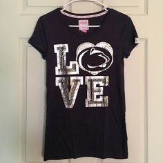 VS PINK Penn State Shirt This is a fitted shirt, NWOT. It's made up of 60% cotton and 40% polyester. It's marked a size small, and has never been washed. The only flaw is that there are a couple stones missing on the back design (shown in pic #3) but it's not even noticeable.     save money with bundles  no trades / paypal  quick shipping ❔ask questions!  pet friendly / smoke free  POSH ON! PINK Victoria's Secret Tops