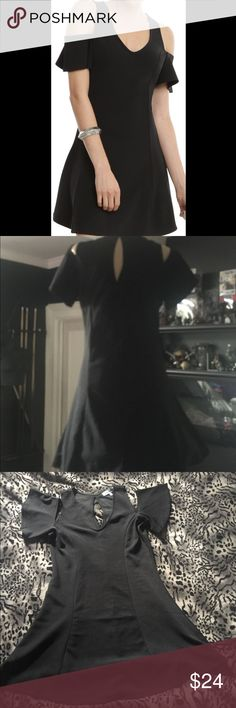 Black Almost Famous cold shoulder dress Black cold shoulder dress made by Almost Famous in size Large. NWOT Almost Famous Dresses Mini