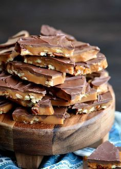 The best toffee recipe EVER! Sweet milk chocolate, crunchy pecans, and rich, buttery toffee - what's not to love? This Better Than Anything Toffee is easy to make and makes the perfect treat OR gift year-round! Don't forget to add this sweet treat to your Christmas trays! // Mom On Timeout #candy #recipe #toffee #chocolate #Christmas #pecans