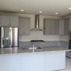Lovely Luna Pearl Granite with White Cabinets