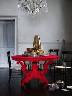 Red table against shades of grey Life Style etc