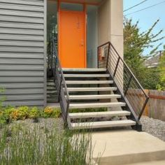 Bright orange door on a gray house - a great contemporary look