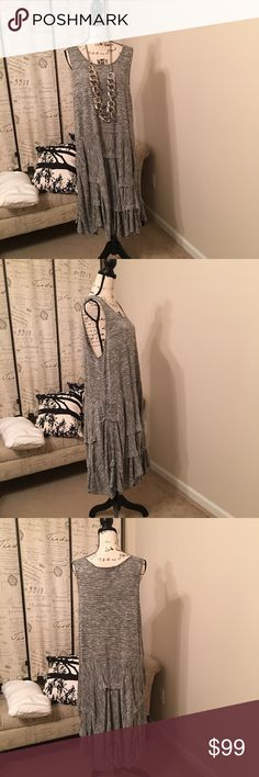 Silver Shimmer Layered Bottomed Dress Silver Shimmer Layered Bottom Dress. 26Wx46L. An awesome piece to layer with other essentials or as a stand alone.  This is a luxury boutique purchase. Comfy  Dresses