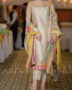 At a dholki/ mayun/ Mehndi - TheTellMeWhy Designer Party Wear Dresses, Kurti Designs Party Wear, Indian Designer Outfits, Indian Outfits, Shadi Dresses, Pakistani Formal Dresses, Pakistani Dress Design, Fancy Dress Design, Stylish Dress Designs